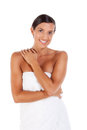 Young caucasian woman wrapped in bath towel with crossed arms Stock Photos