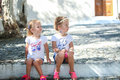Young charming girls sitting at street in old greek village of emporio santorini this image has attached release Stock Photography