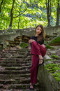 Young charming teenager girl with long dark hair is a graceful gait destroyed by an ancient staircase the steps in striysky park i Royalty Free Stock Photos