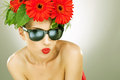Young charming woman with flowers in her hair Royalty Free Stock Photo