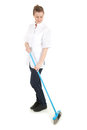 Young charwoman sweeping floor, full length Royalty Free Stock Photos