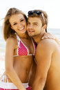 Young cheerful couple having fun on the beach Royalty Free Stock Photos