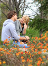 Young cheerful couple in the park Royalty Free Stock Photography