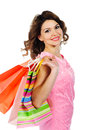Young cheerful girl colorful shopping bags isolated white background Royalty Free Stock Photo