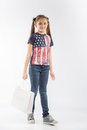 Young and cheerful shopping girl with shopping bags on white background Royalty Free Stock Photo
