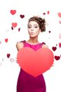 Young cheerful woman holding red paper heart Royalty Free Stock Photos