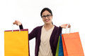 Young cheerful woman holding shopping bags against white Stock Photos