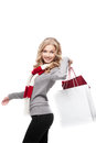 Young cheerful woman holding shopping bags casual blond isolated on white Stock Image
