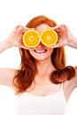 Young cheerful woman with oranges over her eyes Royalty Free Stock Photography