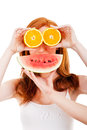 Young cheerful woman with oranges and watermellon over her eyes Royalty Free Stock Photos