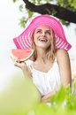 Young cheerful woman wearing pink sunhat with watermelon Royalty Free Stock Photo
