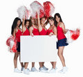 Young cheerleaders holding a blank billboard Royalty Free Stock Photo