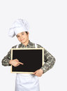 Young chef with blackboard child dressed as a in hand Stock Image