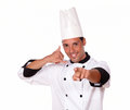 Young chef with call gesture pointing Royalty Free Stock Photos