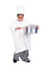 Young chef girl in costume with a wooden spoon and pan Stock Image