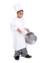 Young chef girl in costume with a wooden spoon and pan Royalty Free Stock Photo