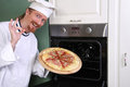 Young chef with italian pizza Royalty Free Stock Photo