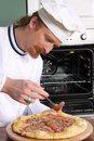 Young chef prepared italian pizza Royalty Free Stock Images