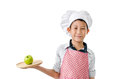 Young chef serving green apple on wooden tray Royalty Free Stock Photo