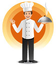 Young chef with steaming cuisine Stock Photo