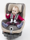 Young child booster seat for a car with in light background studio shot Stock Photos
