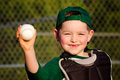 Young child in catcher s gear throwing baseball Royalty Free Stock Photos