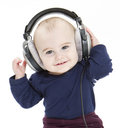 Young child with ear-phones listening to music Stock Photography