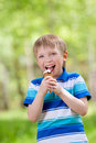 Young child eating a tasty ice cream outdoor Royalty Free Stock Images