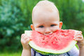 Young Child Eating Watermelon