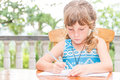 Young child girl writing in notebook, outdoors portrait, educati Royalty Free Stock Photo
