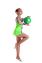 Young child gymnast dance with green ball Royalty Free Stock Photography
