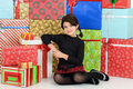 Young child leaning on christmas presents portrait of Royalty Free Stock Images