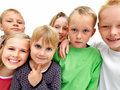 Young child stuck in the middle of young friends Stock Photography