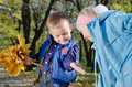 Young Children with Autumn Leaves Royalty Free Stock Photo