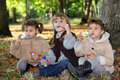Young children blowing bubbles in the woods Stock Image