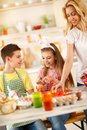 Young children with mother preparing Easter Royalty Free Stock Photo