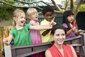 Young children playing in daycare with teacher Royalty Free Stock Photo