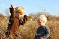 Young Children Playing Outside in Autumn Royalty Free Stock Photo