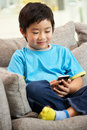 Young Chinese Boy Using Mobile Phone Royalty Free Stock Images