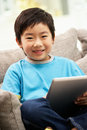 Young Chinese Boy Using Tablet Computer Stock Image