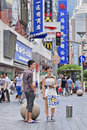 Young Chinese couple in Nanjing East Road, Shanghai, China Royalty Free Stock Photo