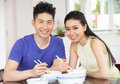 Young Chinese Couple Sitting At Home Eating Meal Stock Photos