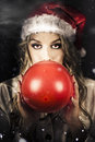 Young Christmas Girl Blowing Up Party Balloon Royalty Free Stock Photography