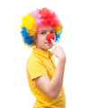 Young clown points to his nose own red Royalty Free Stock Photography