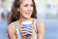 Young coffee drinker woman outdoors with Royalty Free Stock Photos