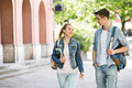 Young college friends talking while walking at campus Royalty Free Stock Photo