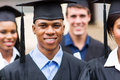 Young college graduates portrait of in graduation gown Royalty Free Stock Photo