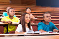 Young college students beautiful african american in lecturing hall Royalty Free Stock Images