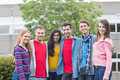 Young college students standing in park group portrait of the Royalty Free Stock Images