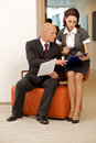 Young confident boss and his secretary looking on documents Royalty Free Stock Images